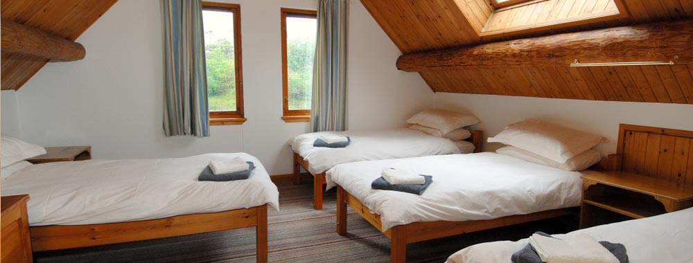 One of the larger bedrooms at the Log House